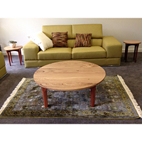 1100 mm diameter retro style coffee table and matching wine tables.Tops are feature grade Blackbutt. Bases are Jarrah.